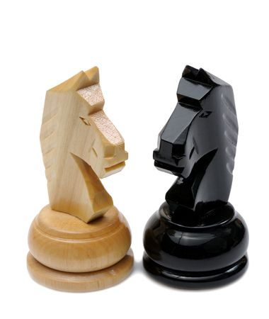 battle: Wooden chess pieces light and dark colors