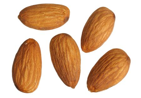Almonds on white background, close up, isolated Stock Photo