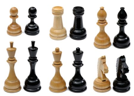 Set of wooden chess pieces light and dark colors photo