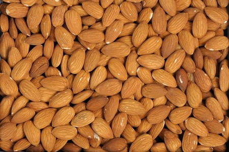 The plant texture, close-up of almonds nuts.