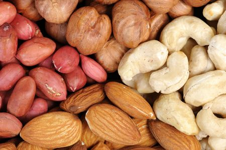 Set of nuts - peanuts, cashews, almonds, walnuts. photo