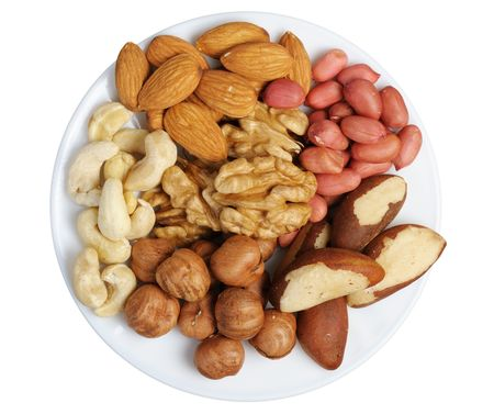 Peanuts, cashews, almonds, walnuts, Brazil nuts and hazelnuts on a white background, isolated photo