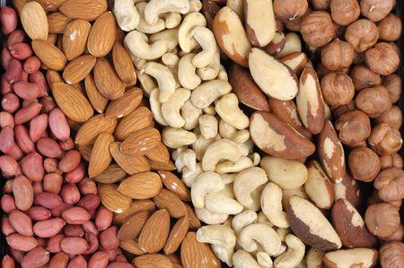 Set of nuts - peanuts, cashews, almonds, Brazil nuts, walnuts. photo