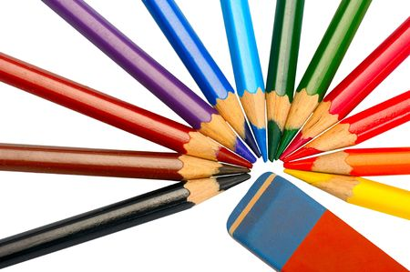 A set of colored pencils and eraser on a white background, isolated photo