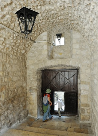 Gate with a small door and lanterns, patio in the old part of Jerusalem. Stock Photo - 7088150