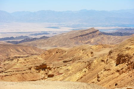 Multi-colored mountains in the south of Israel, the descent to the Gulf of Eilat Red Sea photo