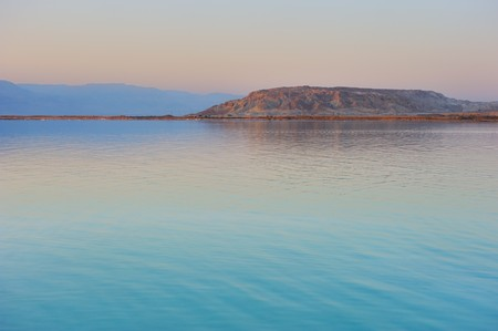 early: Landscape Dead Sea shortly before dawn, salt, water and the Jordanian mountains in the background.