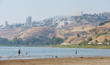 The shore of lake Kinneret near the town of Tiberias in the summer in the morning Stock Photo