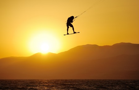 Sky-surfing in the rays of the setting sun on lake Kinneret photo