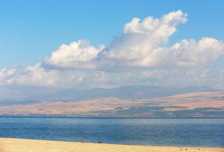 Sea of Galilee in the early morning, ripples on the water and clouds in the sky  Stock Photo