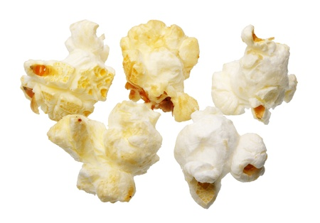 Few grains of popcorn, isolated on a white background Stock Photo