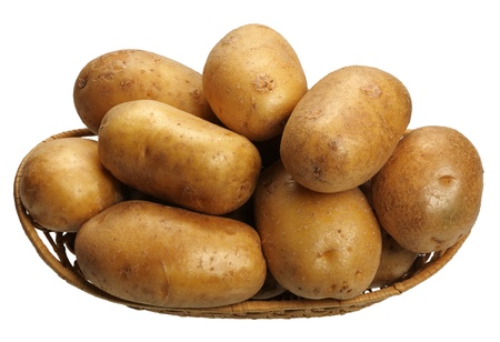 Potatoes in a basket on white background, isolated