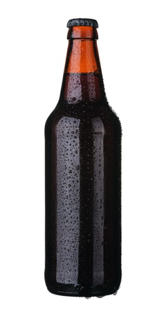 Bottle of dark beer from brown glass, isolated on a white background. photo