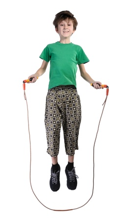 boy in shorts: A boy in a green shirt jumping rope, isolated on a white background
