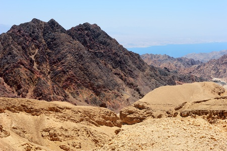 Multi-colored mountains in the south of Israel, the descent to the Gulf of Eilat Red Sea Stock Photo - 9365495