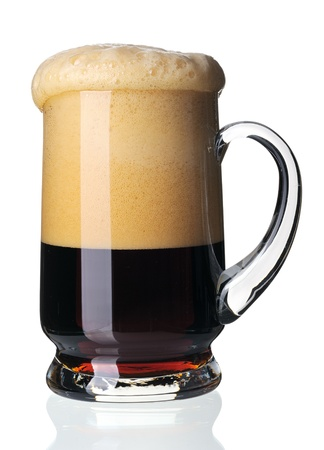 Glass of dark beer, isolated on a white background. Stock Photo