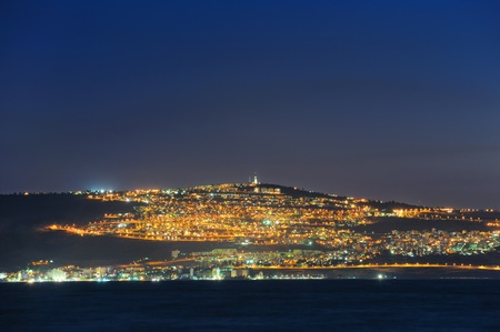 The shore of Lake Kinneret and the city of Tiberias at night Stock Photo