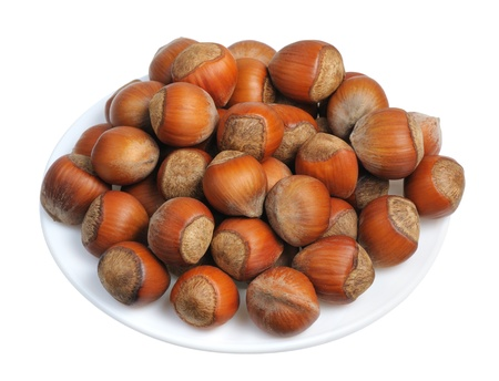 Hazelnuts on a white plate on a white background, isolated Stock Photo - 17754449