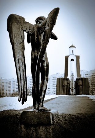 Chapel and a statue of an mourner angel in Minsk, Belarus Stock Photo