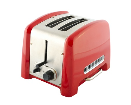 Kitchen appliances - toaster of silver and red color, isolated on a white background Stock Photo