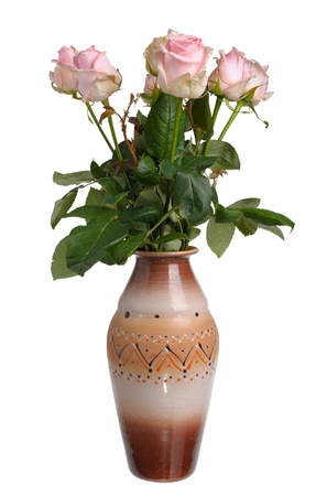 Bouquet of pink roses in a ceramic vase on a white background, isolated photo