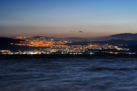 Tiberias city lights late at night on the Sea of Galilee Stock Photo