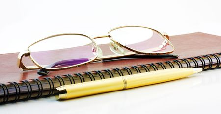 Pen, book and spectacles photo
