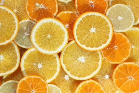 Abstract background from citrus fruit (orange, tangerine, lemon) photo