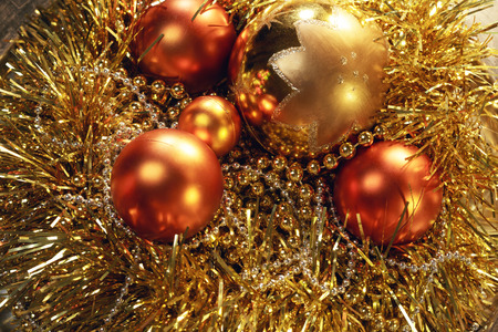 The New years balls and garland on gold background.