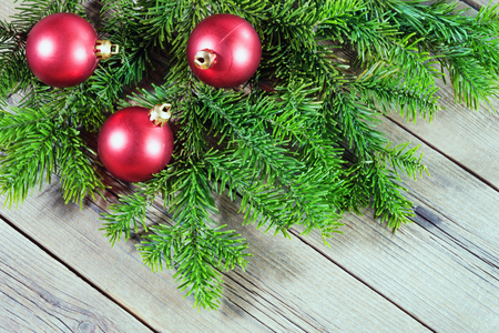 The New years balls and branch spruce on wood background.