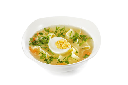 Chicken noodle soup with egg isolated on white background Stock Photo