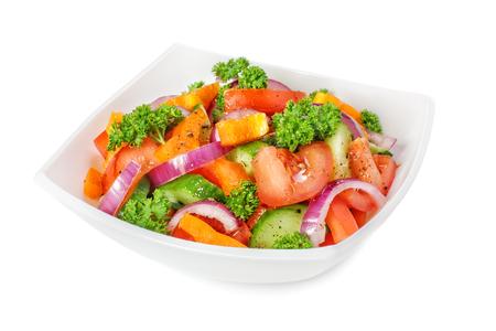 Vegetable salad on white background. Isolated image.