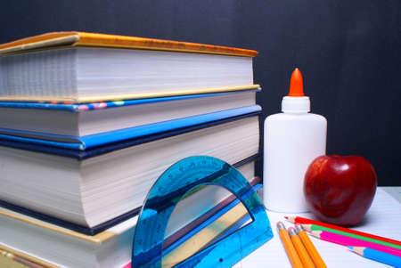 high school teacher: School books in classroom Stock Photo