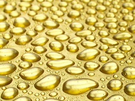 Water droplets on gold background