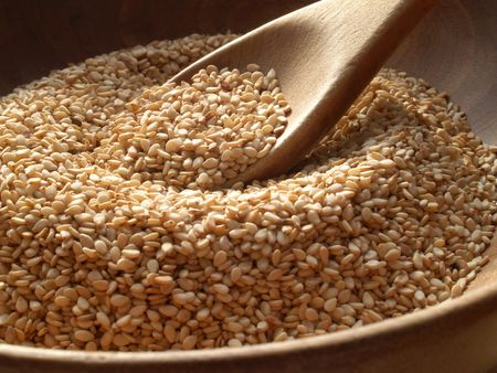 Wooden bowl of sesame seeds Stock Photo