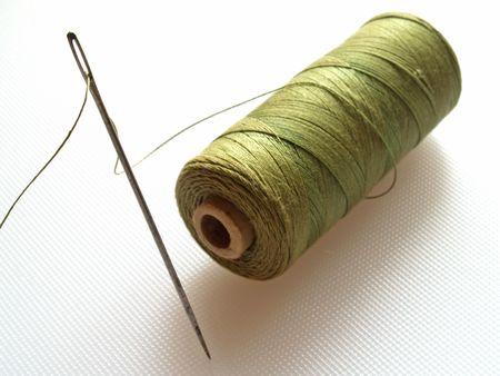threaded: Threaded needle and cotton Stock Photo