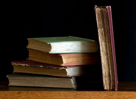 Old books on a wood shelf