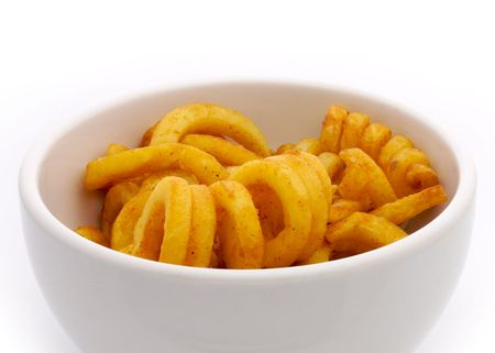 Curly potato fries on white