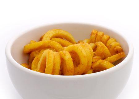 Curly potato fries on white