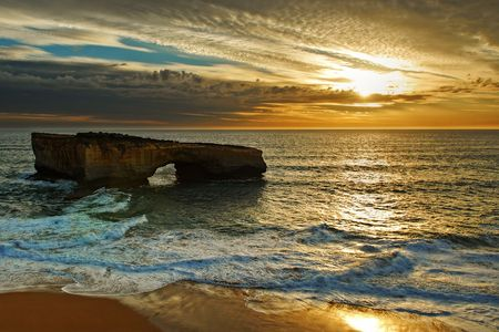 wide open spaces: Sunset at the London Arch of the Great Ocean Road (Australia) Stock Photo