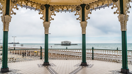 bandstand: The victorian bandstand and the remains of the distroyed West pier in Brighton and Hove