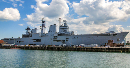 View of aircraft carrier in Portsmouth harbour Stock Photo