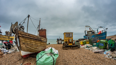 Fish eye view of fishing boats on the beach at Hastings, England. Tractors are used to carry the boats on the beach Stock Photo