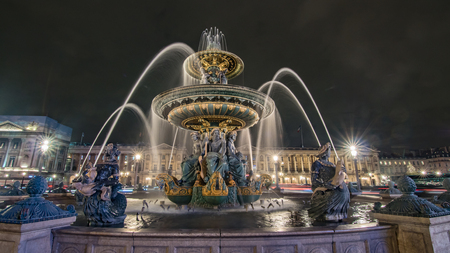 View of a fountain at night in Place de la Concorde in Paris, France