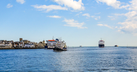 Several boats and ships at the entrance of Portsmouth bay Stock Photo