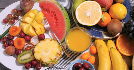Top down view of an assortment of fresh, healthy, organic fruits Stock Photo