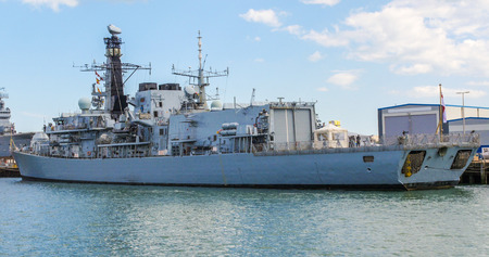 royal: View of a modern warship in Portsmouth harbour