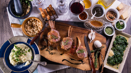 minted: Top down view of  a delicious minted rack of lamb with spinach and mashed potatoes