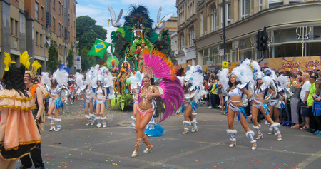 London, Notting Hill carnival. Parade of  dancers in costume Editorial