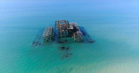 Aerial view of the destroyed West Pier in Brighton on a summer morning